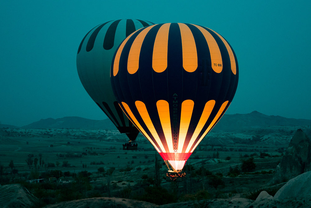 Hot-air balloons taking off, soon to take over the entire sky