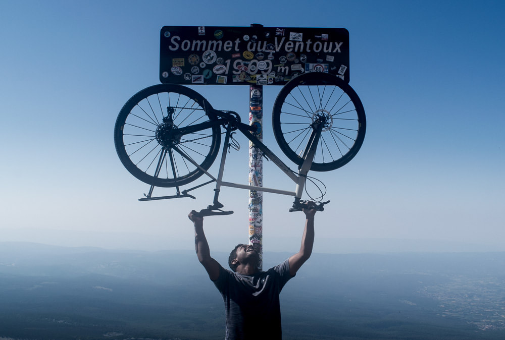 Me, my bike, and the iconic sign at the summit of Mount Ventoux